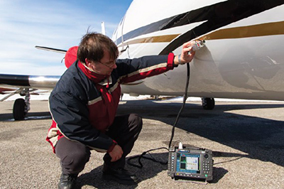 Inspecting an aircraft with eddy current array