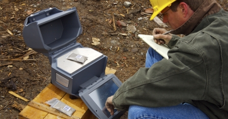 Olympus Innov-X's rugged X-5000 XRF analyzer for in-field analysis of soils, ore, and other samples.